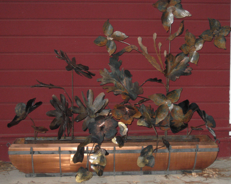 Christine Apostolina Beirne: Commission for a commerical building. Welded Steel with various patina.