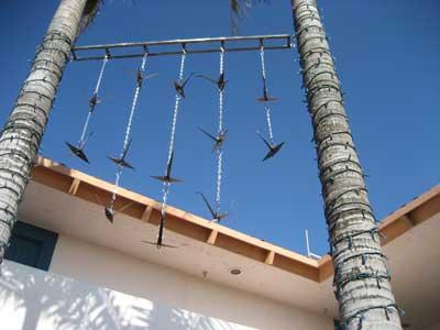 Christine Apostolina Beirne Site-Specific. Welded steel on chains. Harbor Village